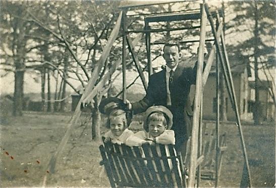 kids swinging behind house