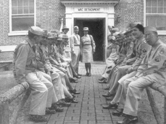 Soldiers seated outside the WAC Detachment on the Wake Forest campus.