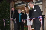 Executive Director Ed Morris, Mayor Vivian Jones, North Carolina Humanities Council liaison Caitlin Patton, and Wake Forest College Birthplace Society President Tom Parrish cut the ribbon.