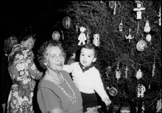 Marie Joyner celebrating Christmas in Wake Forest with her great-nephew Paul Parker, 1971.